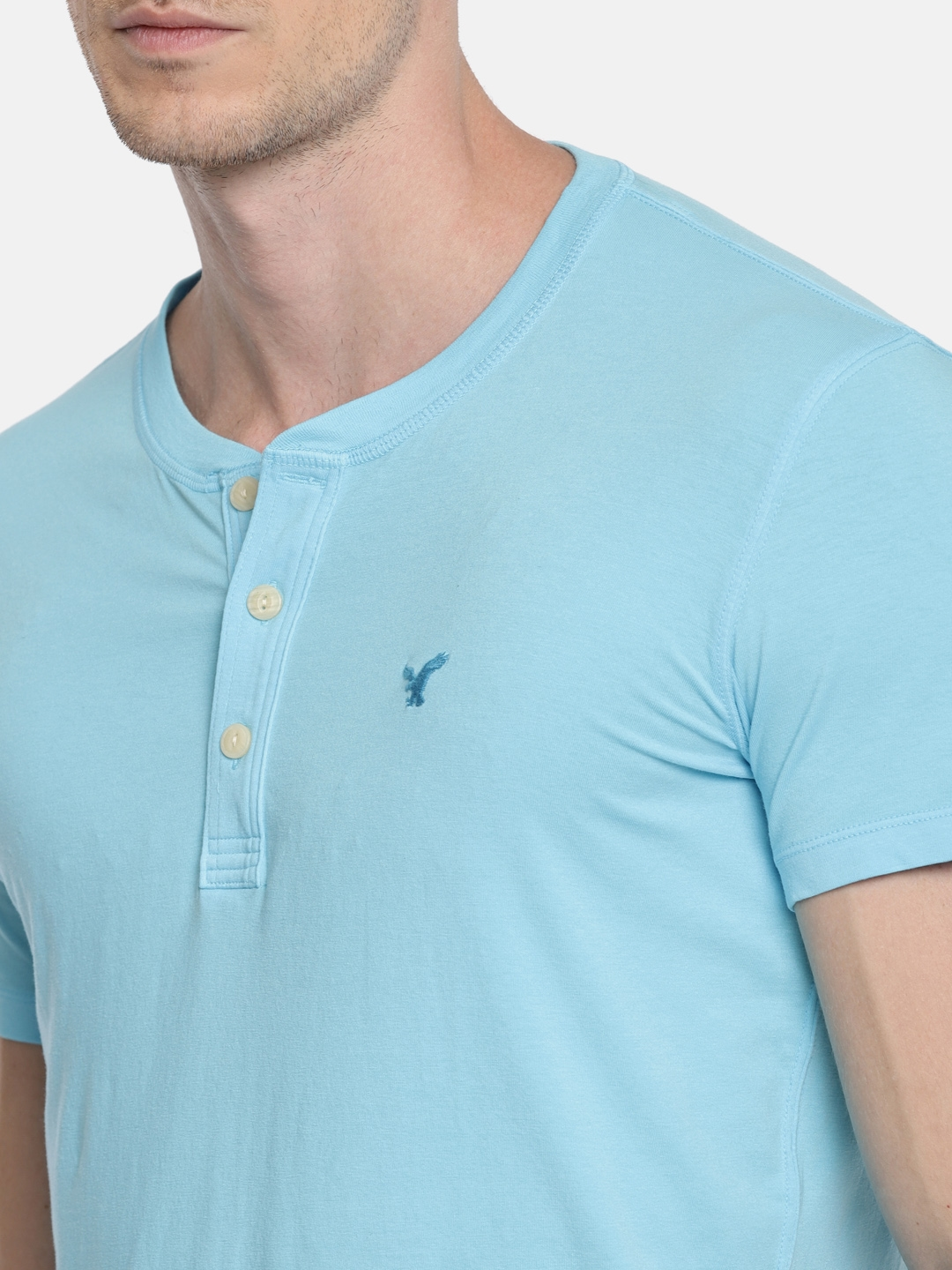 fc1f7a008097a Buy AMERICAN EAGLE OUTFITTERS Men Blue Solid Henley Neck T Shirt ...