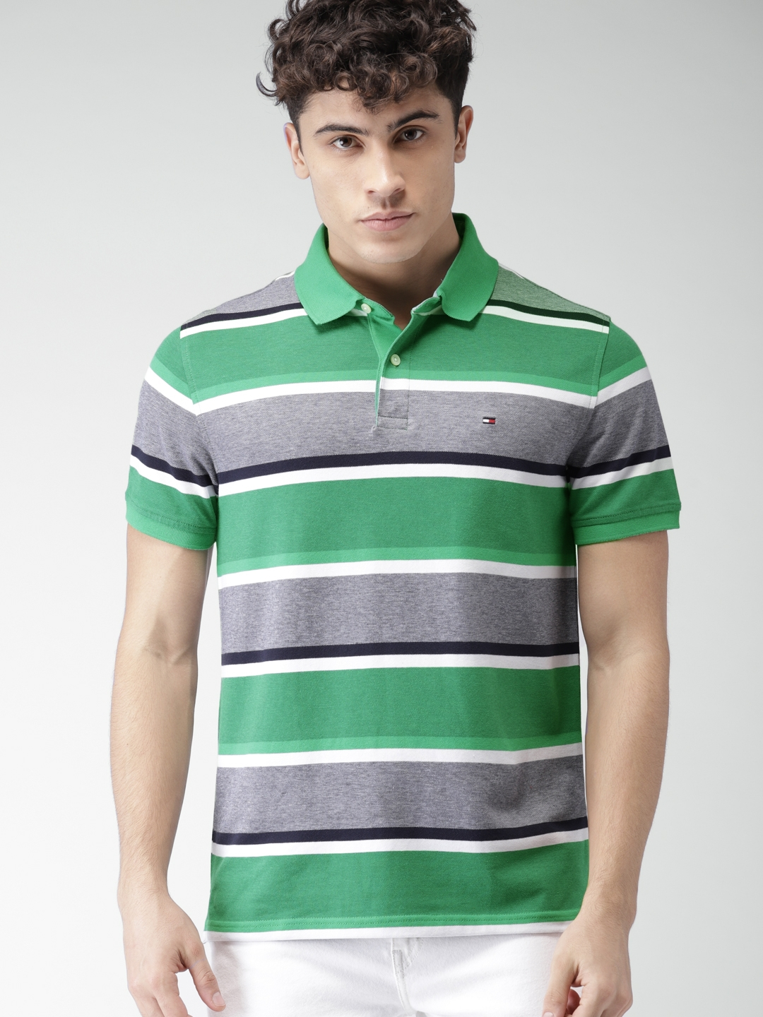 f3ad86189 Buy Tommy Hilfiger Men Green & White Striped Polo Collar T Shirt ...