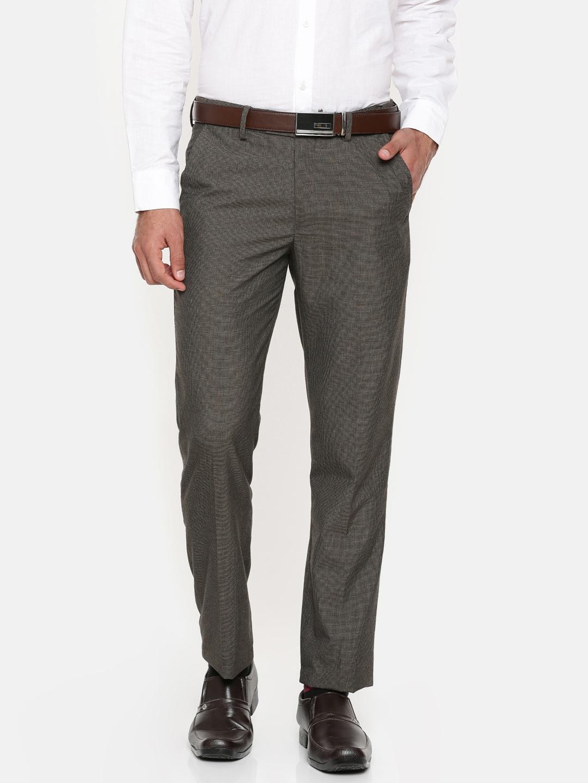 dd918e91e94 Buy Peter England Men Brown Slim Fit Self Design Formal Trousers ...