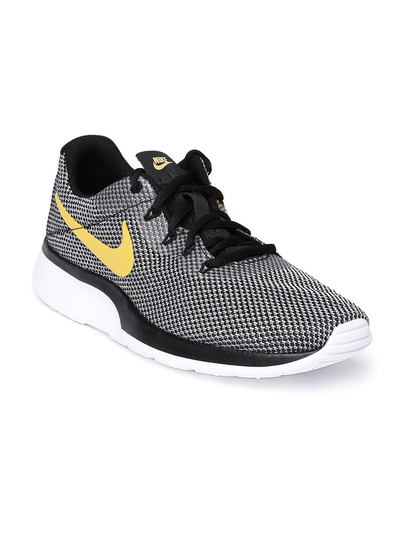 2347f934505a Buy Nike Men Black Tanjun Racer Sneakers - Casual Shoes for Men ...