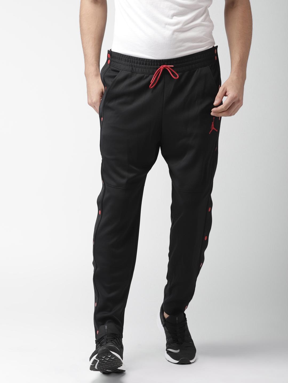 3cb4e50d1b428b Buy Nike Men Black Solid RISE TEAR AWAY JOGGER 2 Track Pants - Track ...