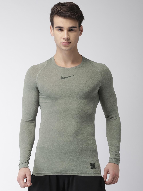 9ef25e30 Buy Nike Men Grey Solid DRI FIT Compression T Shirt - Tshirts for ...