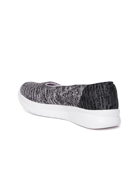 07051634adf5 Buy Reebok Women Black   Lavender Zeal Walking Shoes - Sports Shoes ...