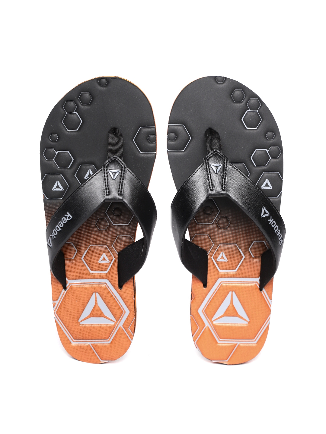 3c8421165 Buy Reebok Men Black   Orange Xtreme Printed Thong Flip Flops - Flip ...
