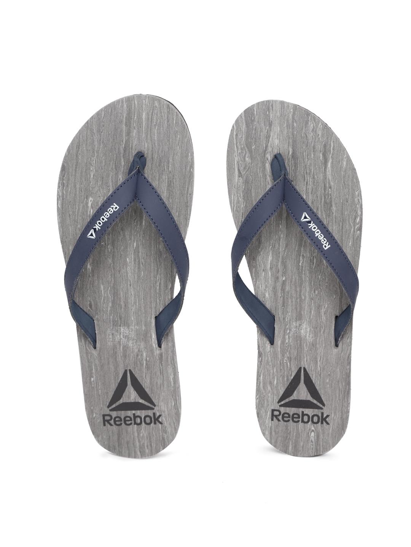 92345e476 Buy Reebok Women Navy Blue   Grey Printed Thong Flip Flops - Flip ...