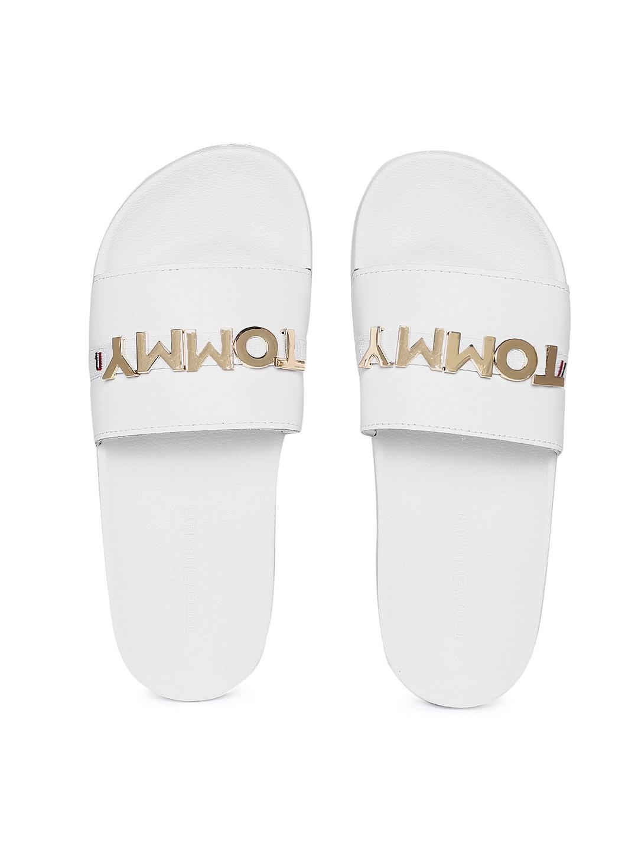 ecb69af5 Buy Tommy Hilfiger Women White Sliders - Flip Flops for Women ...