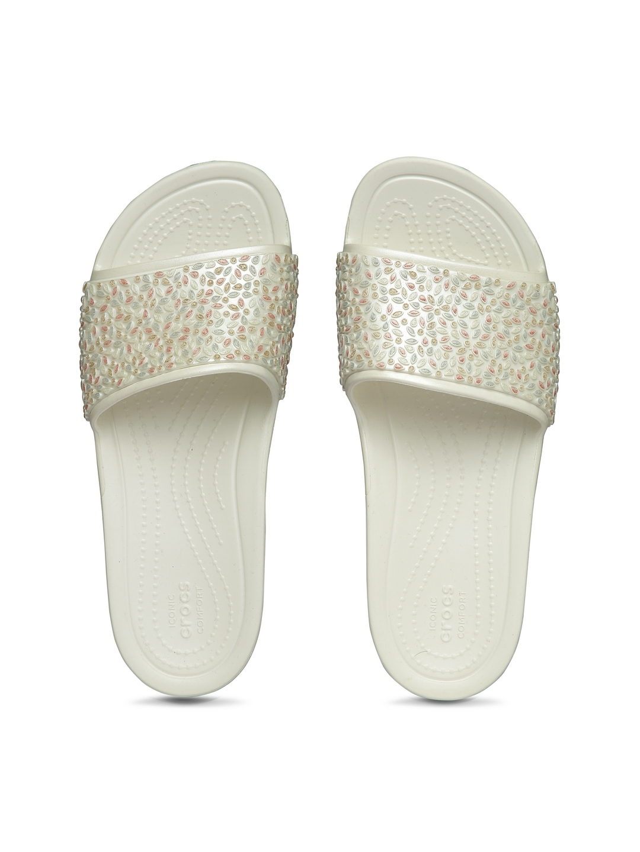 5a488deac Buy Crocs Women Off White Self Design Sliders - Flip Flops for Women ...