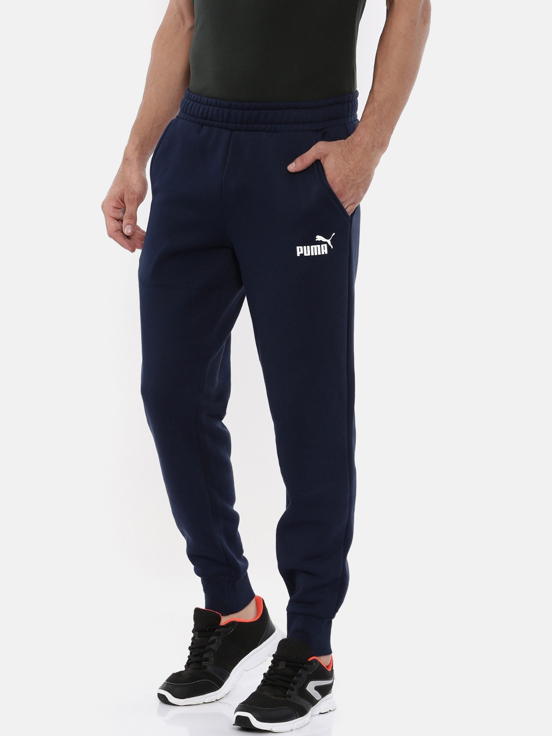 a4301d35a Buy Puma Men Navy Blue Solid Regular Fit ESS Logo Pants FL Sports ...