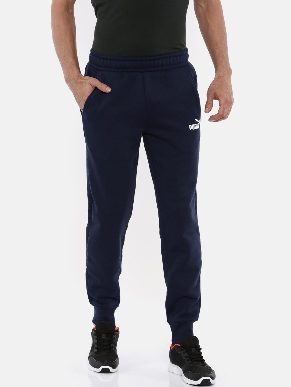 54831edf3bb6 Buy Puma Men Navy Blue Solid Regular Fit ESS Logo Pants FL Sports ...