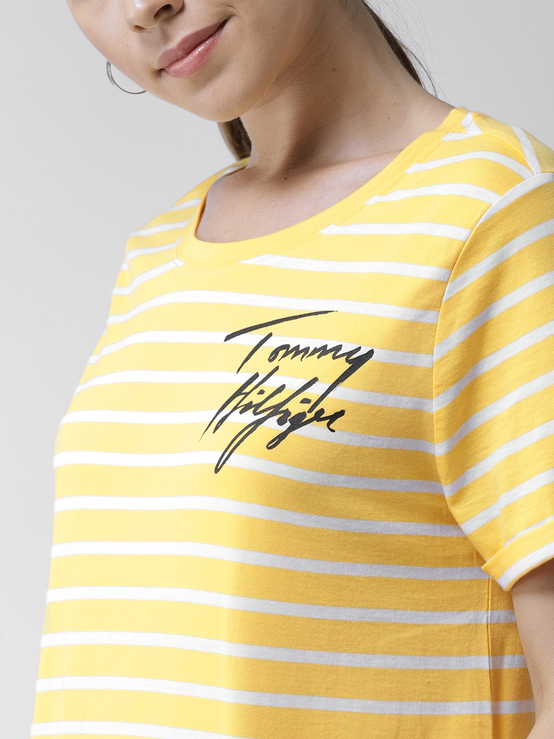 0d7d667a Buy Tommy Hilfiger Women Yellow & White Striped Round Neck T Shirt ...