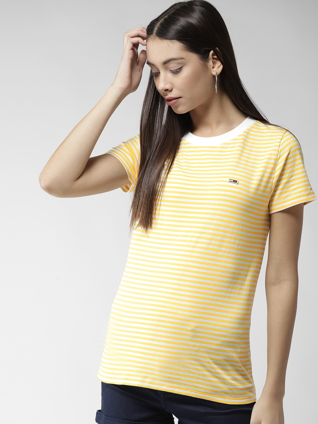 a5df9a5a Buy Tommy Hilfiger Women White & Yellow Striped Round Neck T Shirt ...