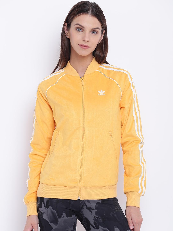 50b7d9135ee Buy ADIDAS Originals Women Yellow Solid SST TT Sporty Jacket ...