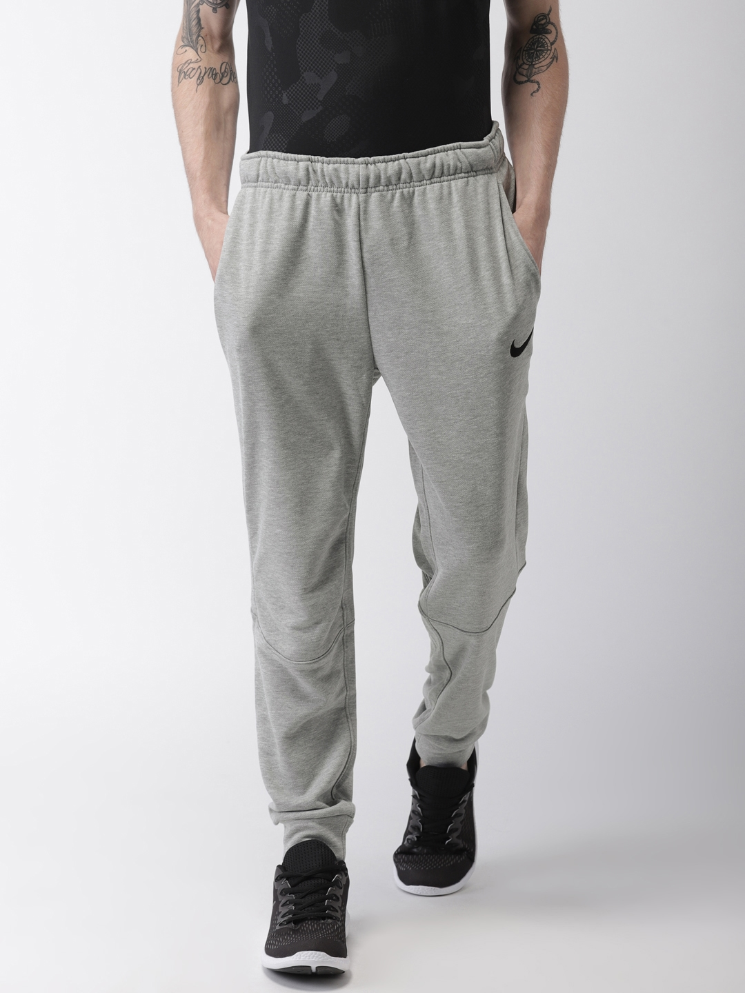 496f86ab1bd4e Buy Nike Men Grey DRY TAPER FLEECE Solid Joggers - Track Pants for ...