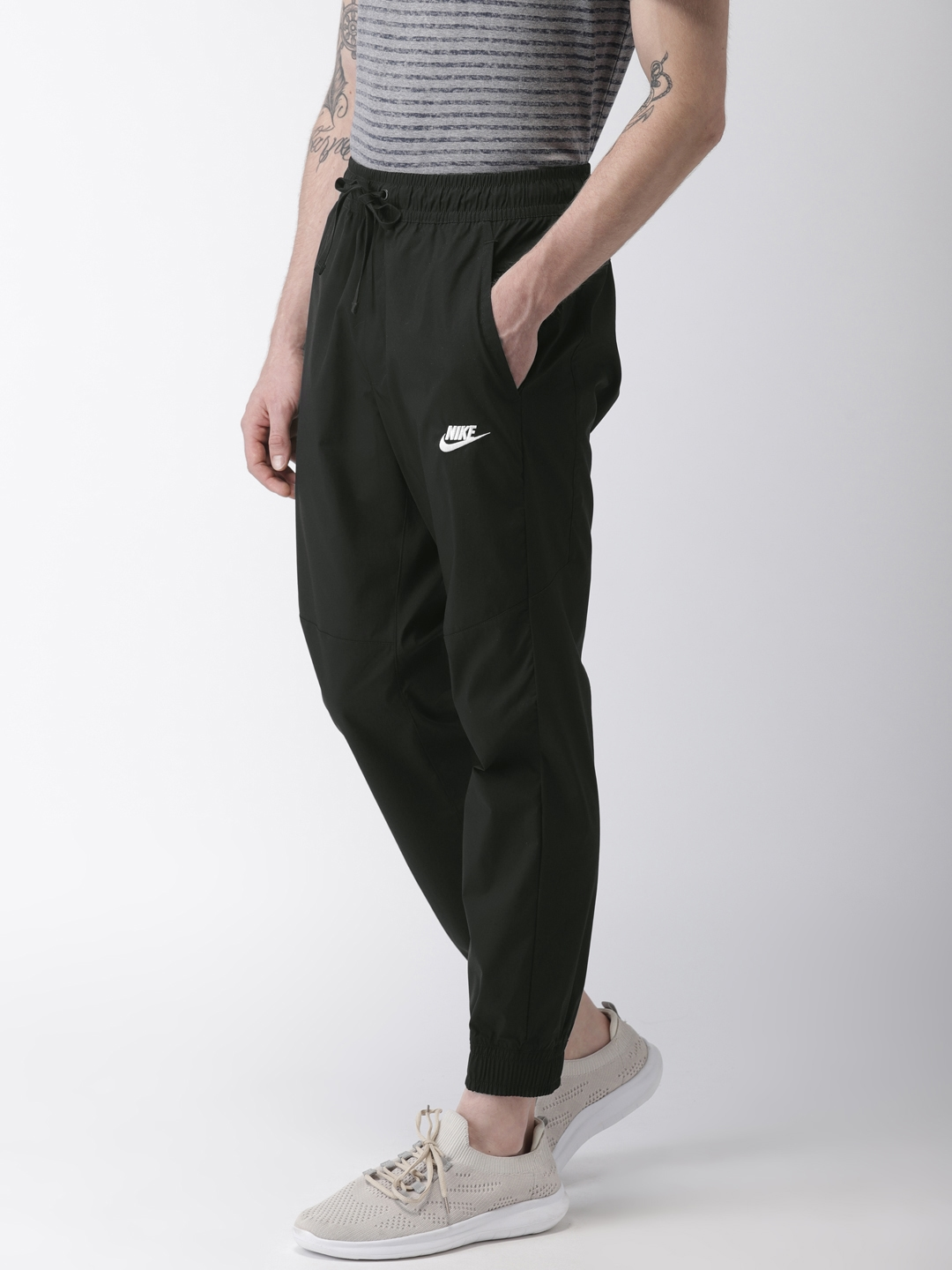 85c9630e6ca7 Buy Nike Black AS NSW CORE STREET Solid Joggers - Track Pants for ...