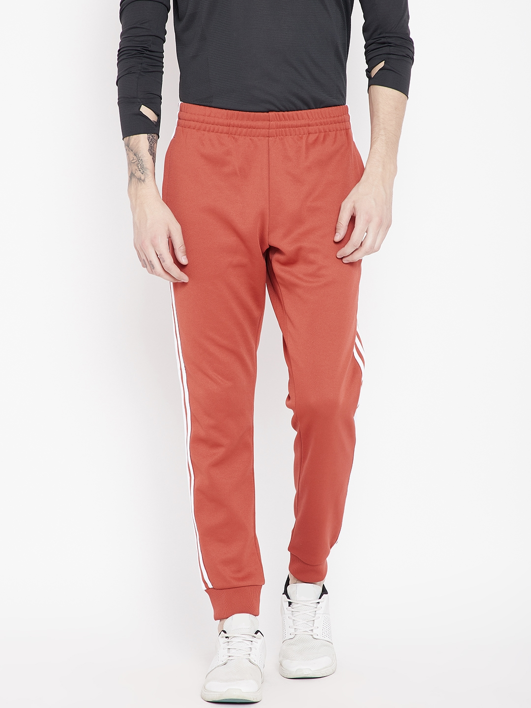 Buy ADIDAS Originals Men Rust Orange Solid Slim Fit SST