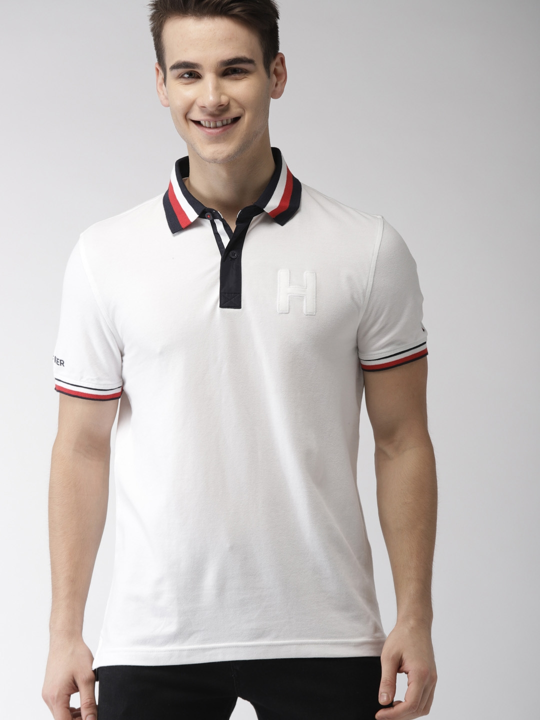 70b33f02 Buy Tommy Hilfiger Men White Solid Polo Collar T Shirt - Tshirts for ...