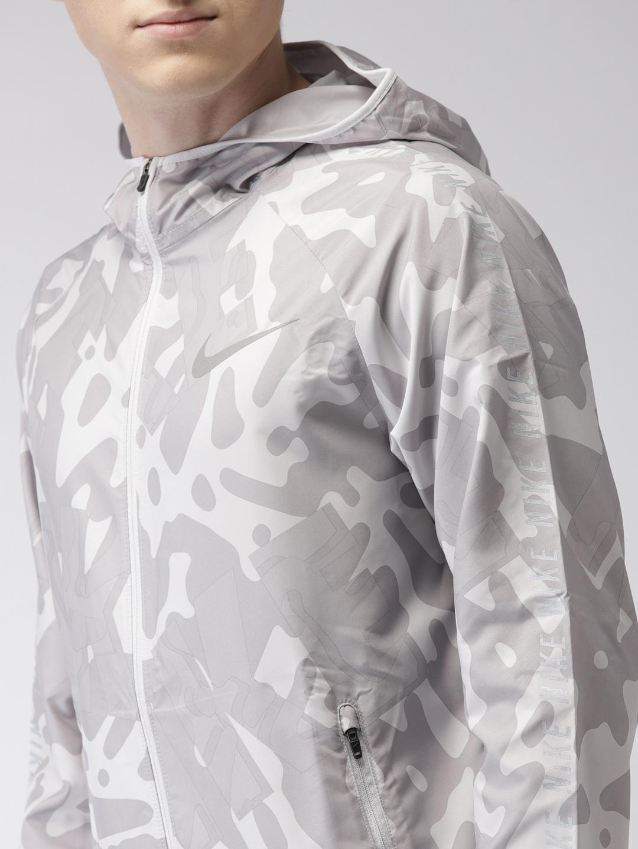 e05ca5ca66320 Buy Nike Men Grey   Off White AS M NK ESSNTL JKT HD FL GX Printed ...