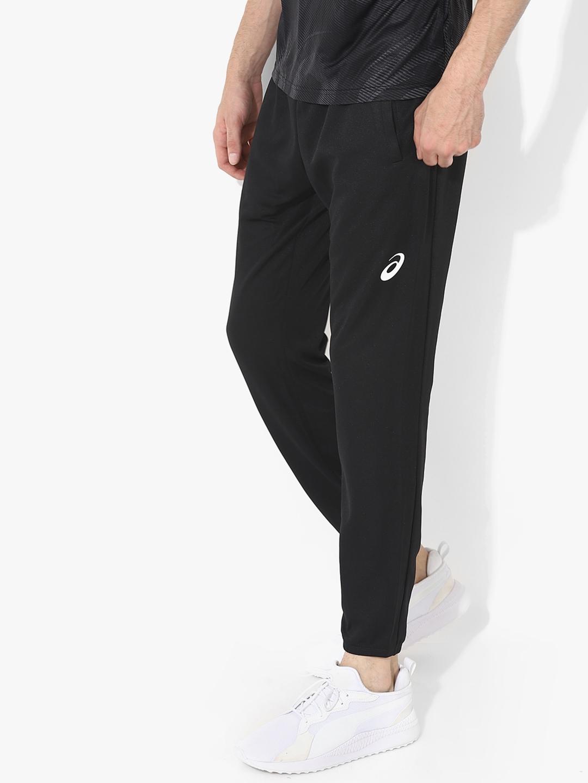 10112b074303 Buy ASICS Men Grey Solid ENTRY Joggers - Track Pants for Men 7746456 ...