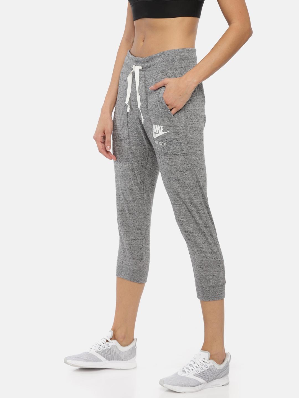 25b63b0a445e Buy Nike Women Grey Melange Solid Regular Fit Three Fourth Joggers ...