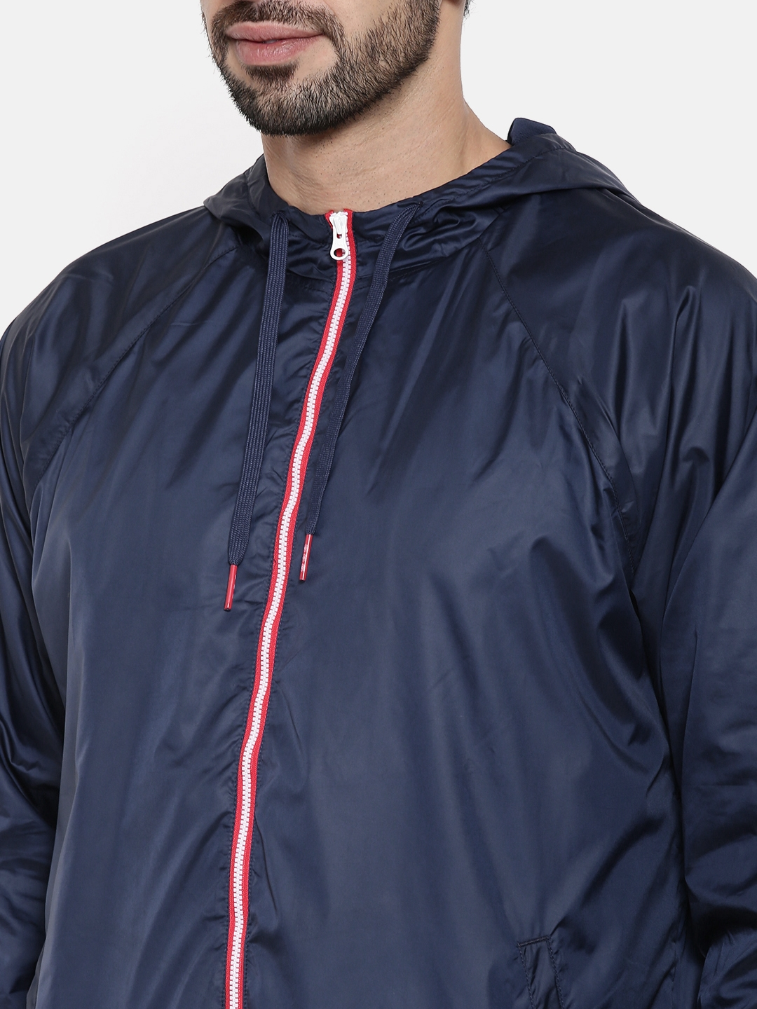 8d5f9f6ed426 Buy Reebok Classic Men Blue Solid AC F WINDBREAKER Sporty Jacket ...