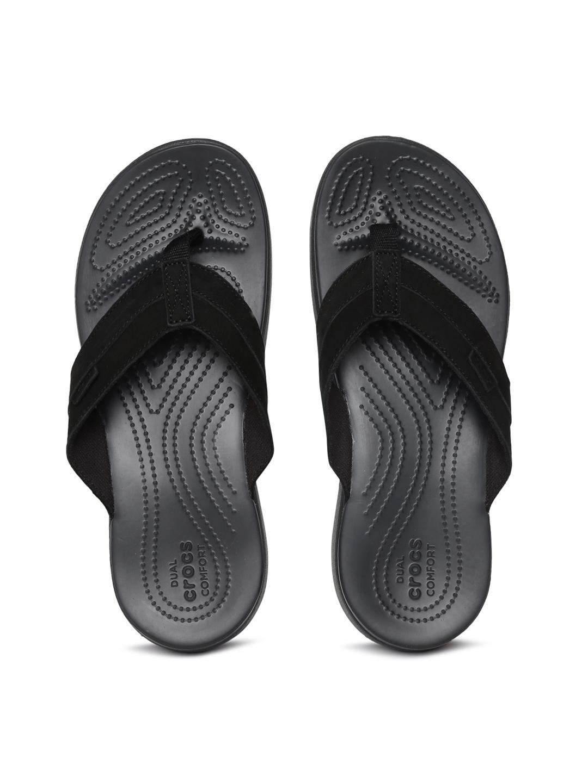 e4d3b152a49c Buy Crocs Men Black Solid Leather Thong Flip Flops - Flip Flops for ...