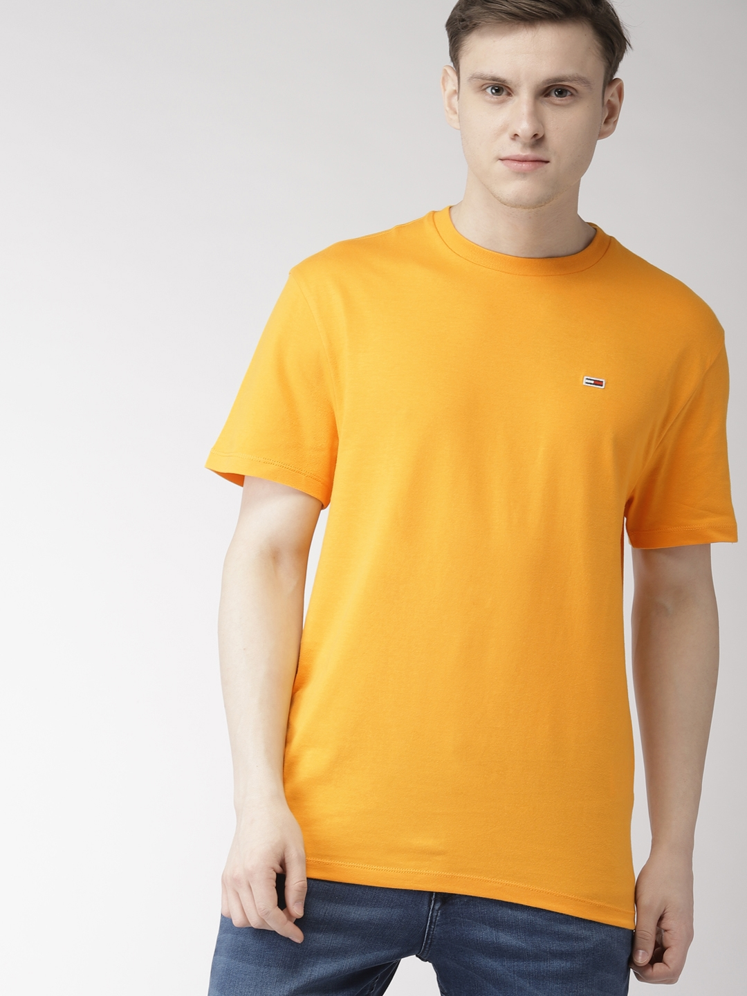 2cd04083049c9 Buy Tommy Hilfiger Men Mustard Yellow Solid Round Neck T Shirt ...