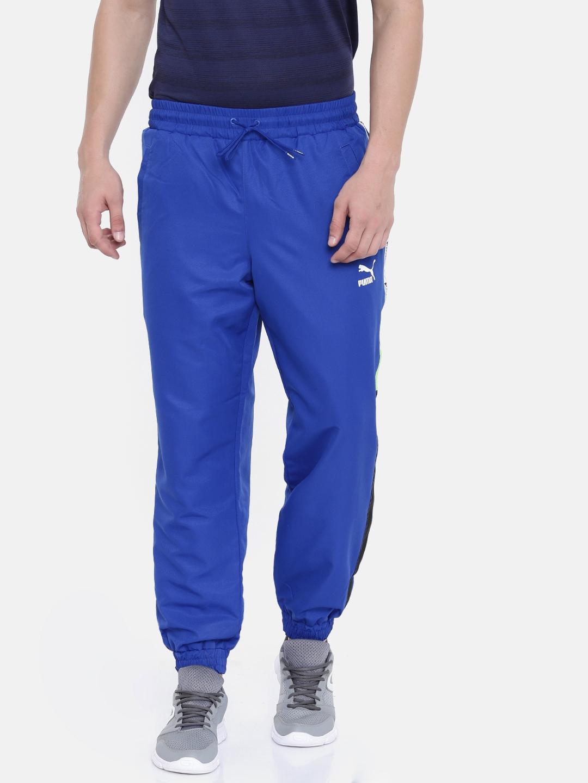4489da98414d Buy Puma Men Blue Regular Fit Solid XTG Woven Joggers - Track Pants ...