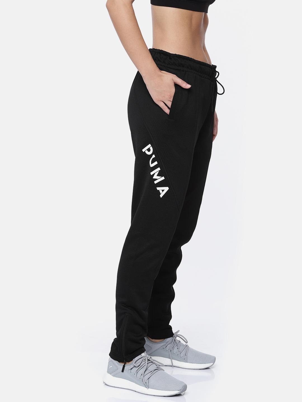 210bf082 Buy Puma Women Black Solid XTG 94 Track Pants - Track Pants for ...