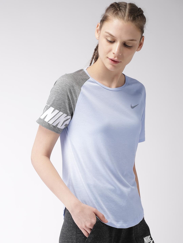 87f00f7db9c Buy Nike Women Blue Solid Standard Fit MILER DRI FIT Running T Shirt ...