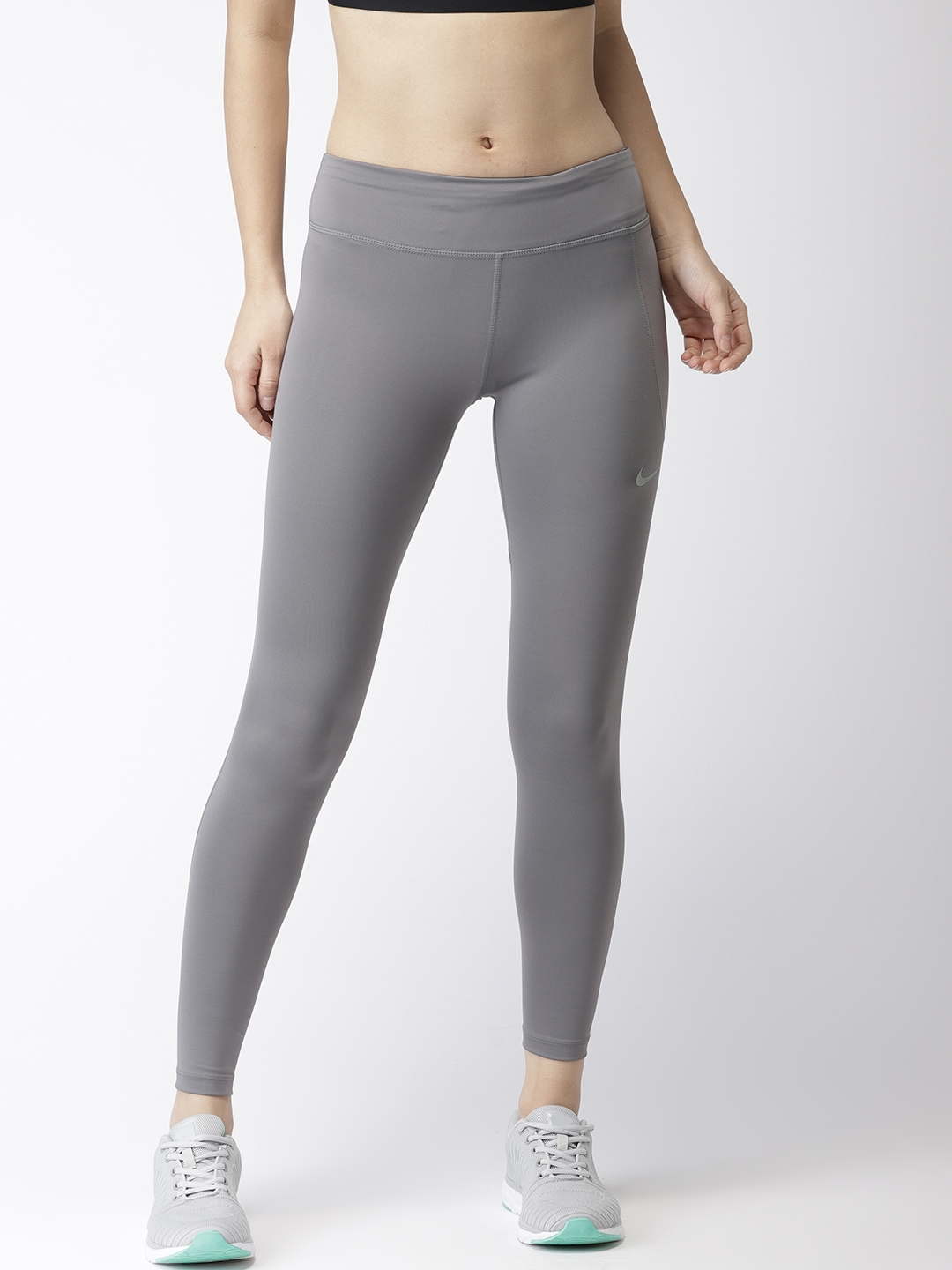fa729490bfeb7 Buy Nike Women Grey Solid Tight Fit FAST Dri FIT Running Tights ...