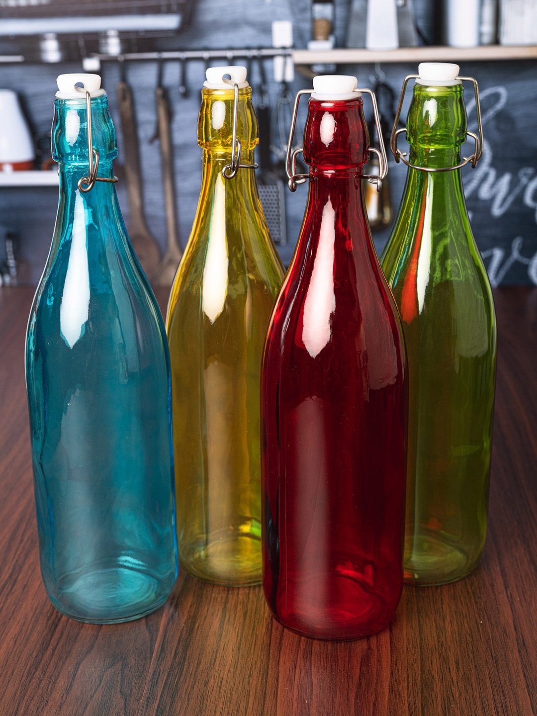 GOODHOMES Set of 4 Glass Bottles with Airtight Caps