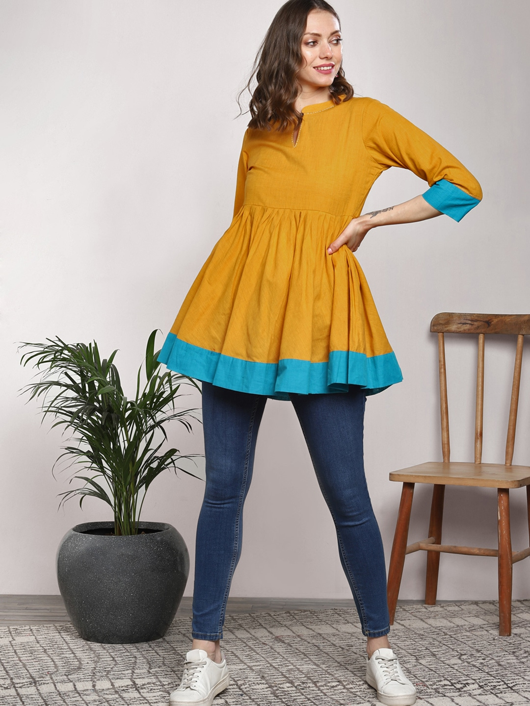 Sangria Women Mustard Yellow Solid Pleated A-Line Kurti
