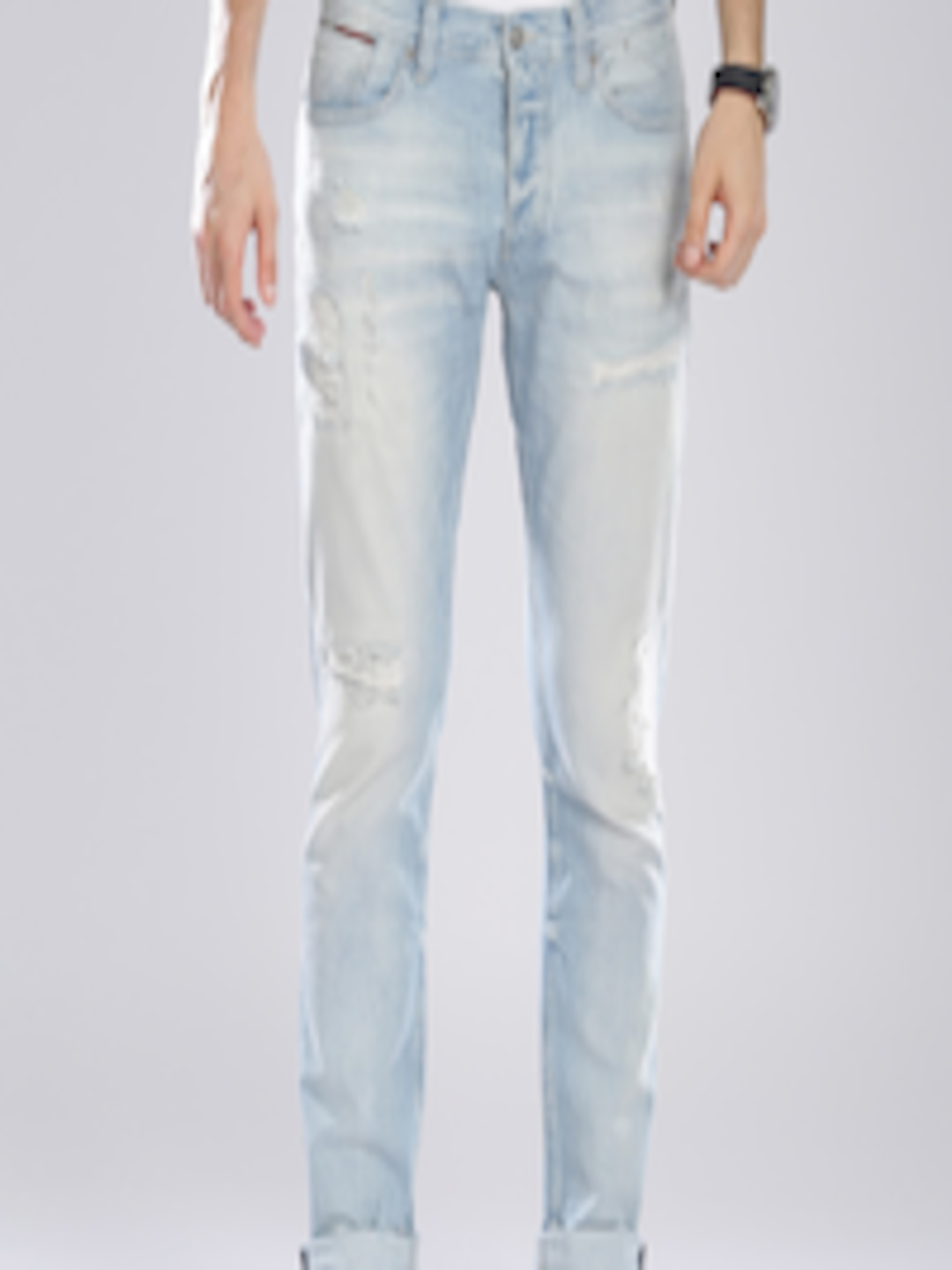 d0aa7fcf Buy Tommy Hilfiger Men Blue Tapered Fit Mid Rise Ripped Jeans - Jeans for  Men 1473619 | Myntra