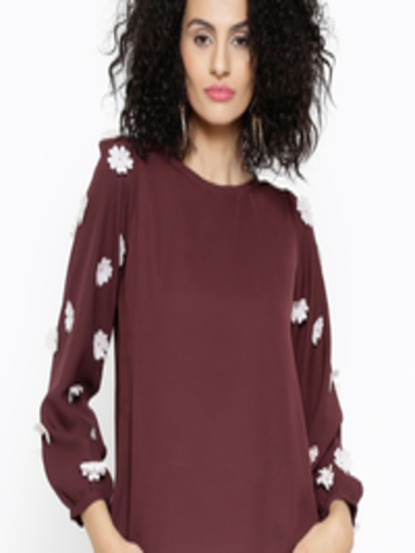 sassafras women Off-white solid a-line kurta with tie-up along the waist, has a mandarin collar, three-quarter sleeves, flared hem, button closure cotton dry-clean.