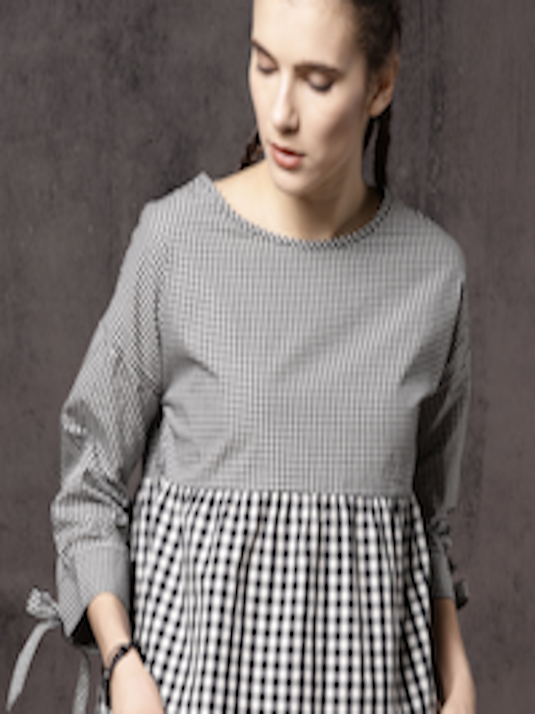 441f77a9a63f05 Buy Roadster Time Travlr Women Black Checked Peplum Top - Tops for ...