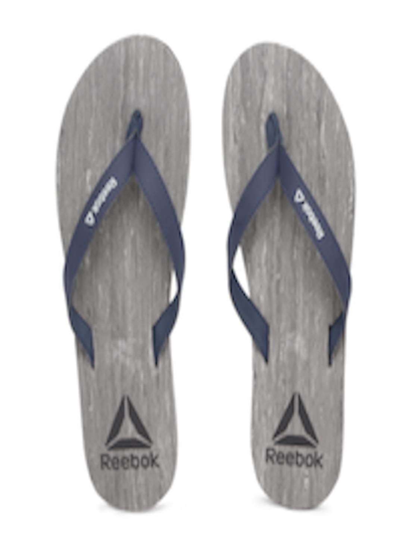 9cb0e5ed6671 Buy Reebok Women Navy Blue   Grey Printed Thong Flip Flops - Flip ...