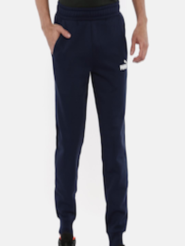 2948b6bdcc4d Buy Puma Men Navy Blue Solid Regular Fit ESS Logo Pants FL Sports Joggers -  Track Pants for Men 7033426