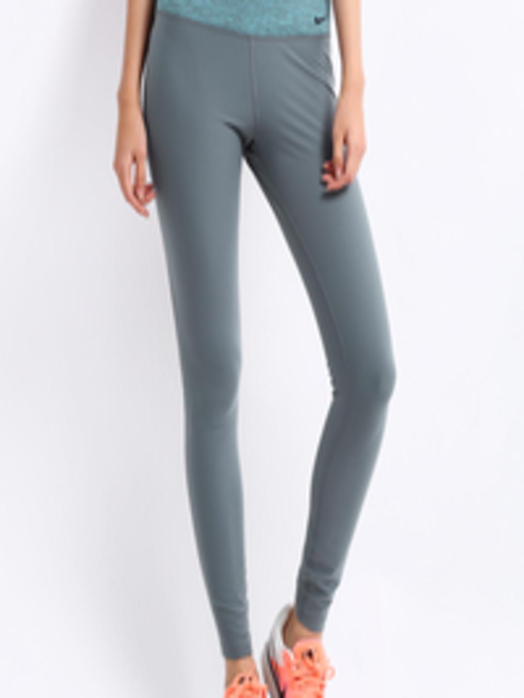 e2e9fd61 Buy Nike Women Grey Legend 2.0 Tight Fit Track Pants - Track Pants for Women  224633 | Myntra