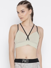 874c384c06 Reebok Beige Strappy Solid Non-Wired Lightly Padded Sports Bra BR8988