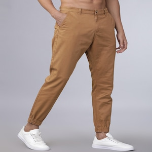 [Size 30, 32] Horsefly Men Beige Slim Fit Solid Joggers worth Rs. 1559 for Rs. 559 - Myntra
