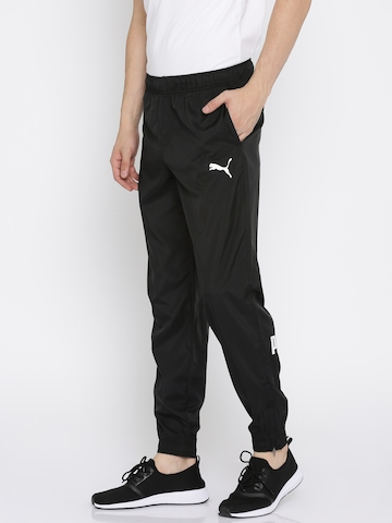 4a43cdc854 Buy Puma Men Black Slim Fit ESS No.1 Woven Track Pants on Myntra |  PaisaWapas.com