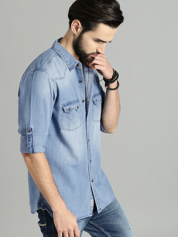 c90e643a171 30% OFF on Roadster Men Blue Regular Fit Faded Denim Casual Shirt on Myntra