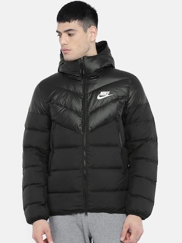 aac875ec23 40% OFF on Nike Men Black Solid NSW DWN FILL WR Standard Fit Water  Resistant Hooded Puffer Jacket on Myntra