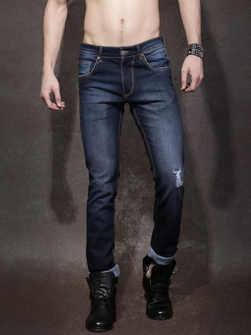 ab17ce00ae2 Buy Roadster Men Blue Skinny Fit Mid Rise Mildly Distressed Jeans on Myntra    PaisaWapas.com