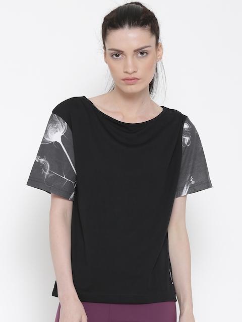 Reebok Classic Women Black FLORAL GR Solid Round Neck T-shirt
