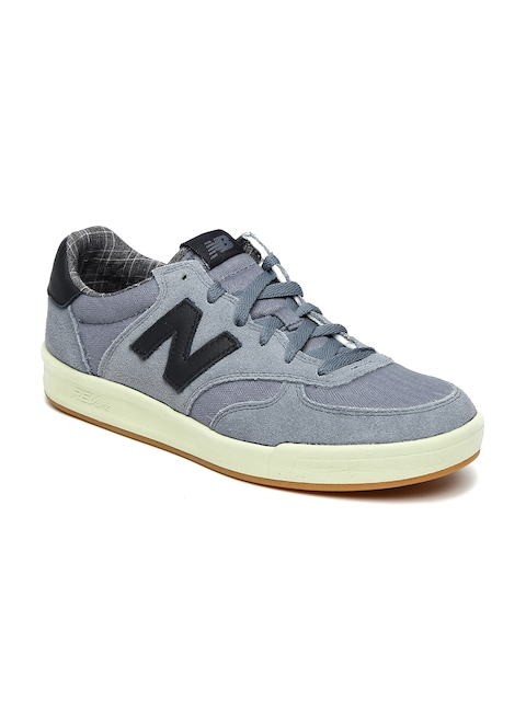 New Balance Men Blue Solid Leather Sneakers