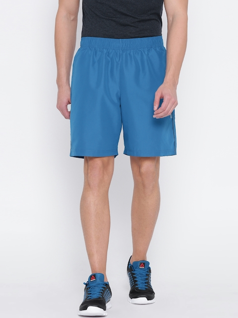 Reebok Men Blue COR Woven Solid Training Shorts  available at myntra for Rs.749
