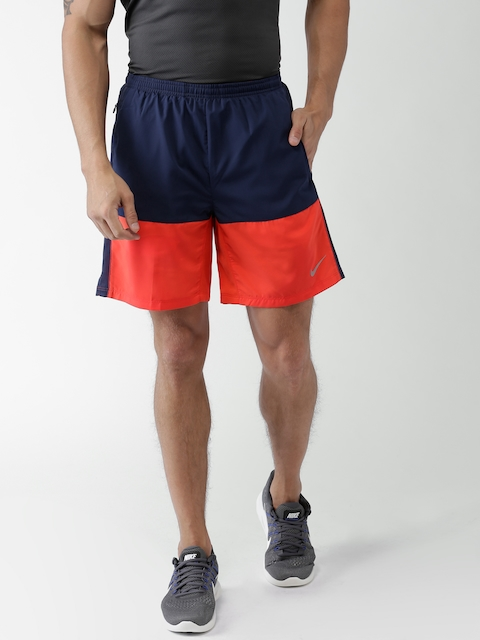 Nike Men Navy Blue & Orange AS Distance Colourblocked Sports Shorts  available at myntra for Rs.658