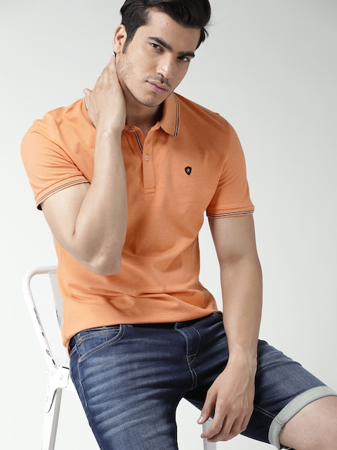 Celio Men Orange Solid Slim Polo Collar T-shirt  available at myntra for Rs.909