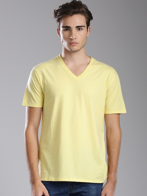Levis Men Yellow Solid T-shirt  available at myntra for Rs.499